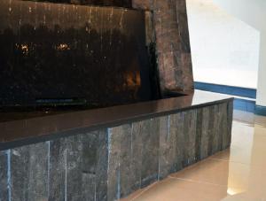 FSI commercial flooring, stone, & tile installs for Forest Park Medical Center fountain